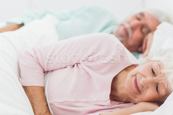 Couple sleeping in bed Stock photo © wavebreak_media