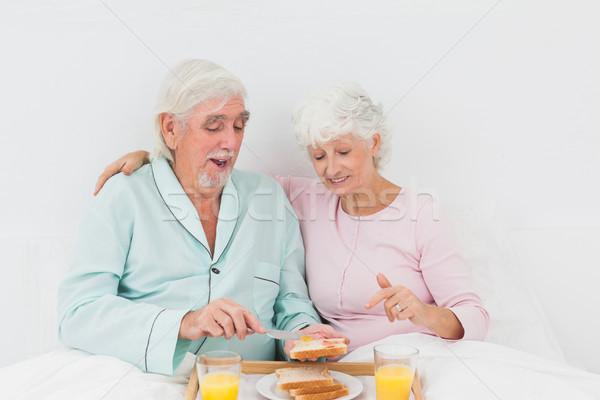 Gelukkig paar ontbijt bed oude paar man Stockfoto © wavebreak_media
