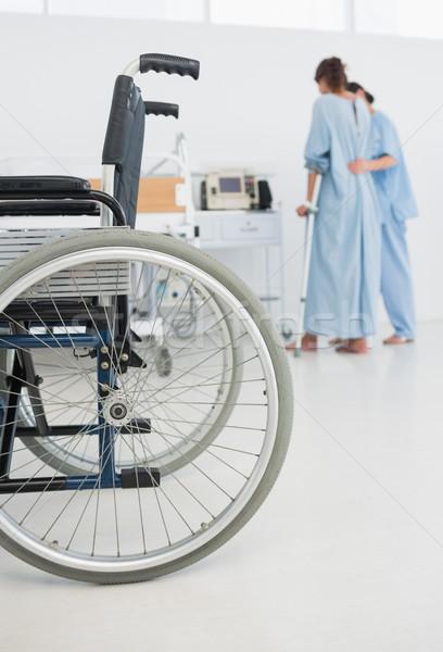 Orvos segít beteg séta tolószék előtér Stock fotó © wavebreak_media