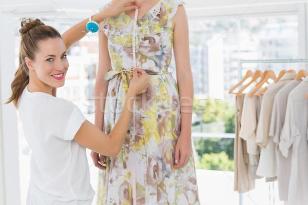 Portrait of a female fashion designer measuring model Stock photo © wavebreak_media