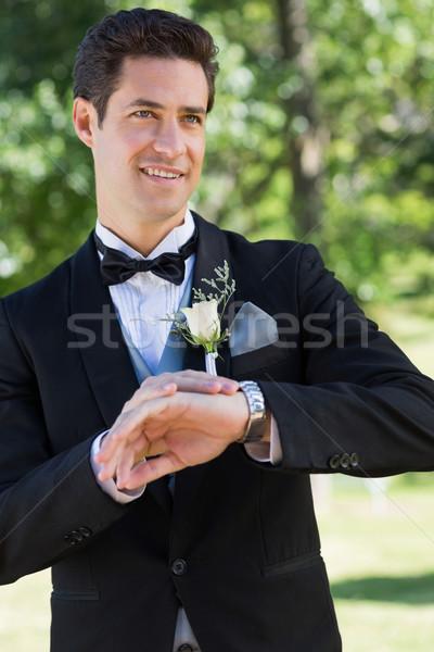 Bridegroom waiting in garden Stock photo © wavebreak_media