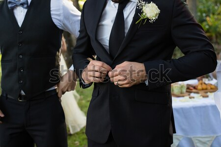 Midsection of bridegroom checking time Stock photo © wavebreak_media