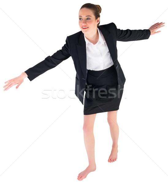 Imprenditrice bilanciamento atto bianco piedi Foto d'archivio © wavebreak_media