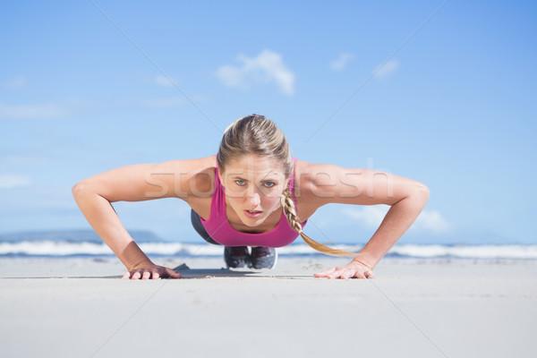 Fit blonde in plank position on the beach Stock photo © wavebreak_media