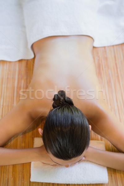 Content brunette relaxing on massage table Stock photo © wavebreak_media