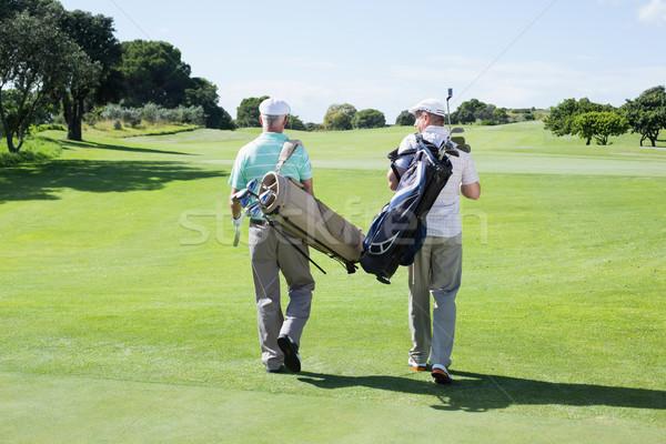 Golfçü arkadaşlar yürüyüş golf çanta Stok fotoğraf © wavebreak_media