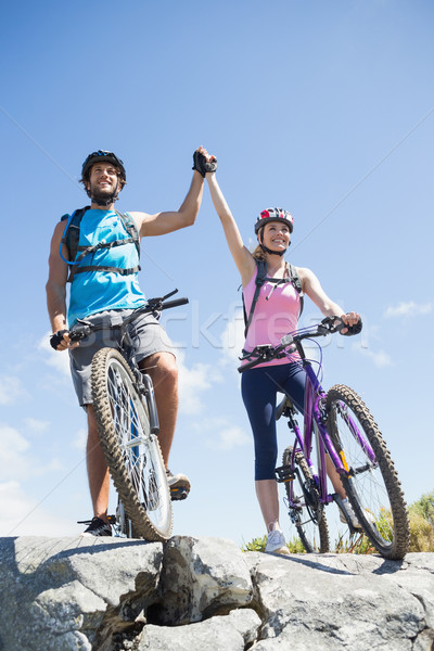 Fit cyclist couple happy to have reached the summit Stock photo © wavebreak_media