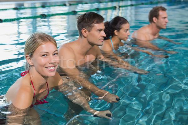 Fitnessz osztály víz aerobik testmozgás biciklik Stock fotó © wavebreak_media