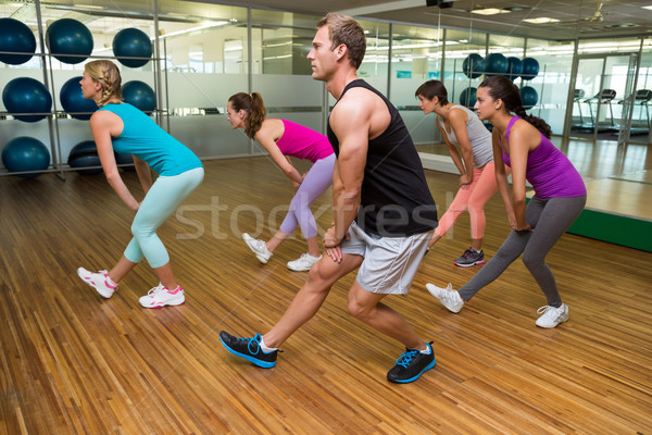 Fitness class led by handsome instructor Stock photo © wavebreak_media