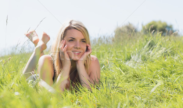 Pretty blonde in sundress lying on grass  Stock photo © wavebreak_media