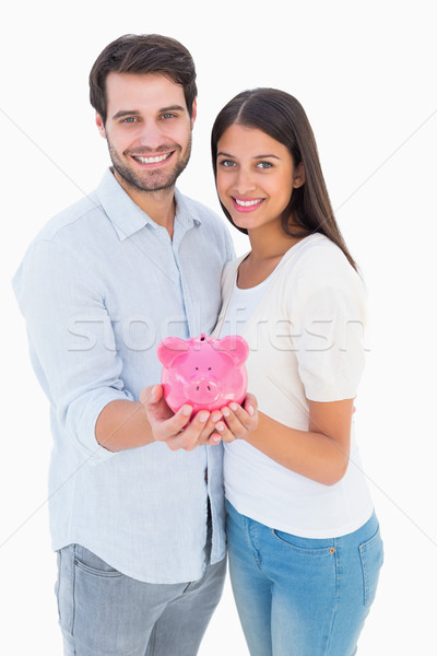 Feliz casal piggy bank branco amor Foto stock © wavebreak_media
