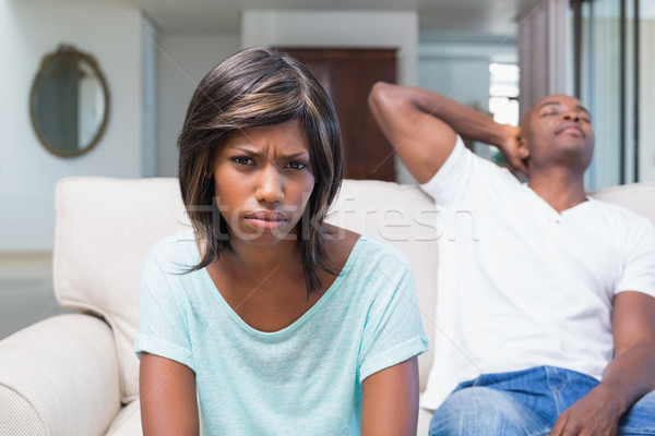 Unhappy couple not talking after argument on sofa Stock photo © wavebreak_media