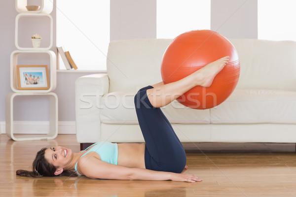 Passen Brünette Heben Ausübung Ball Beine Stock foto © wavebreak_media
