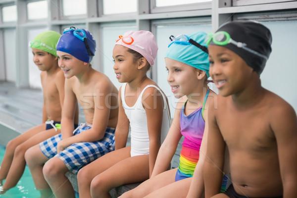 Cute swimming class smiling poolside Stock photo © wavebreak_media