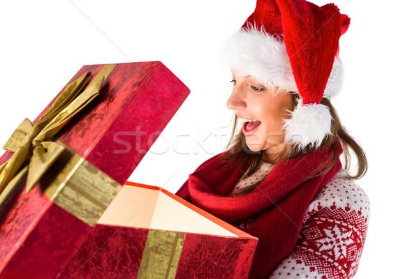 Maravilhado menina abertura natal dom Foto stock © wavebreak_media