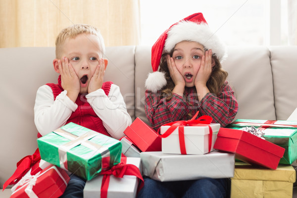 Festive siblings surrounded by gifts Stock photo © wavebreak_media
