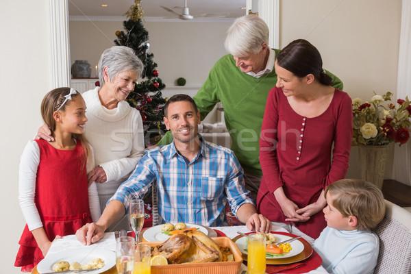 Happy extended family at christmas time Stock photo © wavebreak_media