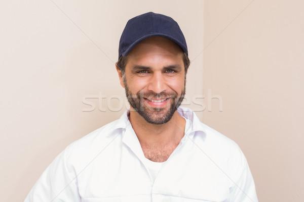Złota rączka uśmiechnięty kamery domu człowiek Zdjęcia stock © wavebreak_media