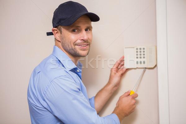 Handyman fixing an alarm system Stock photo © wavebreak_media