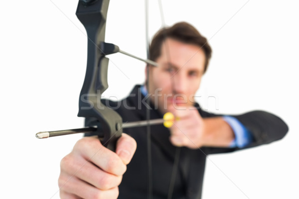 Close up of businessman shooting bow and arrow Stock photo © wavebreak_media