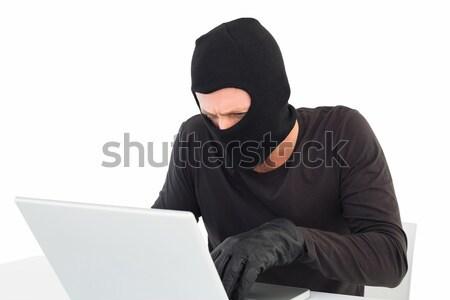 Hacker using laptop to steal identity Stock photo © wavebreak_media