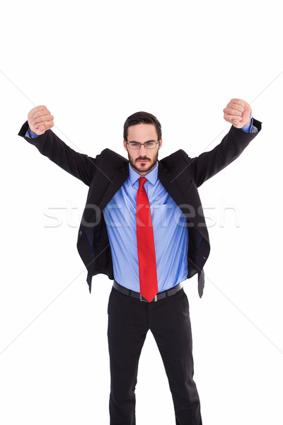 Unsmiling businessman standing with arms raised Stock photo © wavebreak_media