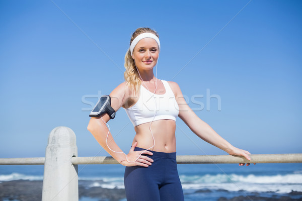 Stock photo: Fit blonde listening to music