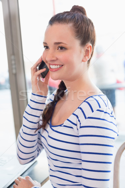 Young woman on the phone Stock photo © wavebreak_media