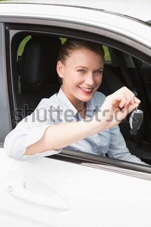 笑顔の女性 座って ホイール 新しい車 ショールーム 女性 ストックフォト © wavebreak_media