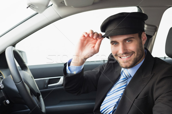 Handsome chauffeur smiling at camera Stock photo © wavebreak_media