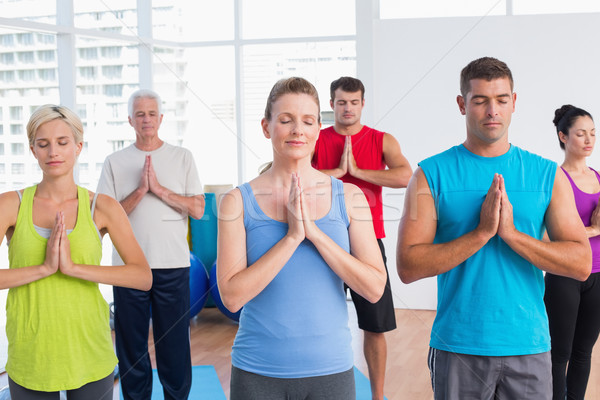 People meditating with hands joined in fitness club Stock photo © wavebreak_media