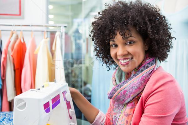 Female fashion designer using sewing machine Stock photo © wavebreak_media