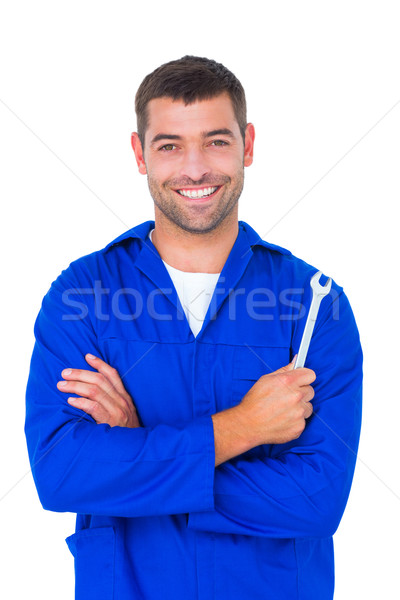 Smiling male mechanic holding spanner Stock photo © wavebreak_media