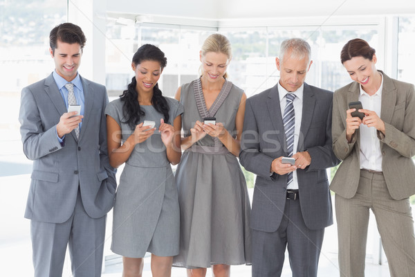 Stock photo: Employees using their mobile phone