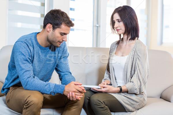Psicólogo falante deprimido homem escritório mulher Foto stock © wavebreak_media