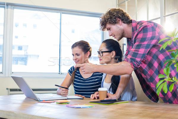 Smiling partners working together on laptop and digitizer Stock photo © wavebreak_media