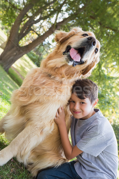 Little boy with his dog in the park Stock photo © wavebreak_media