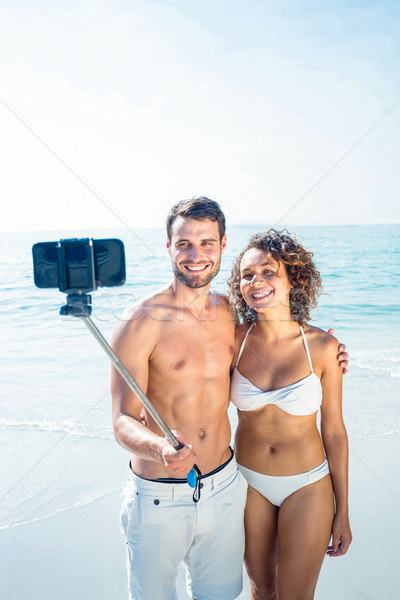 Happy couple doing selfie with monopod Stock photo © wavebreak_media