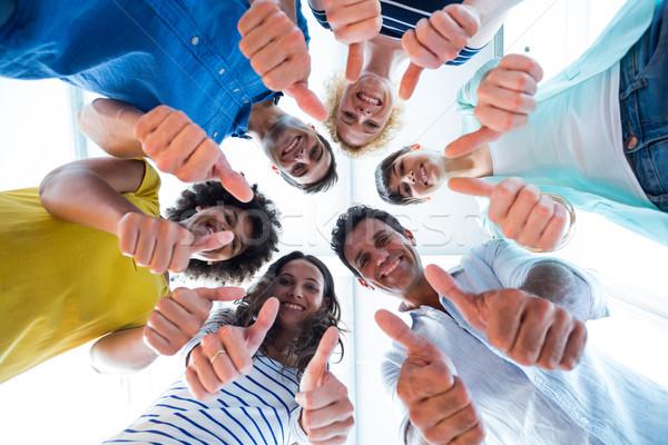 Creative team gesturing thumbs up  Stock photo © wavebreak_media