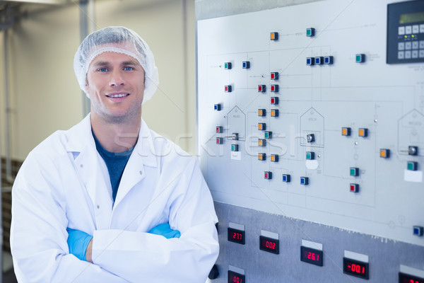 Portrait of a smiling scientist with arms crossed Stock photo © wavebreak_media