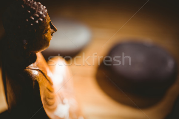 Wooden buddha statue on table Stock photo © wavebreak_media
