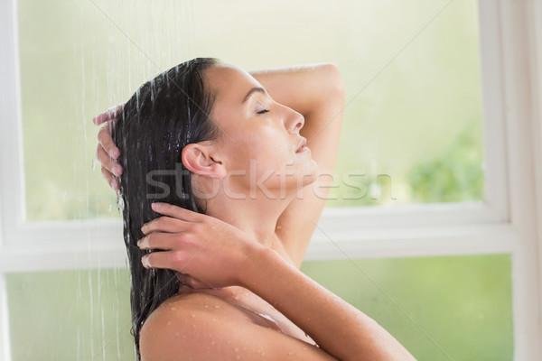 Pretty brunette taking a shower  Stock photo © wavebreak_media