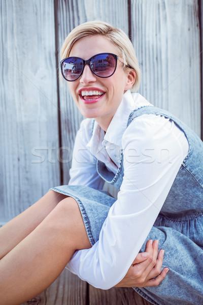 Pretty blonde woman wearing sun glasses Stock photo © wavebreak_media
