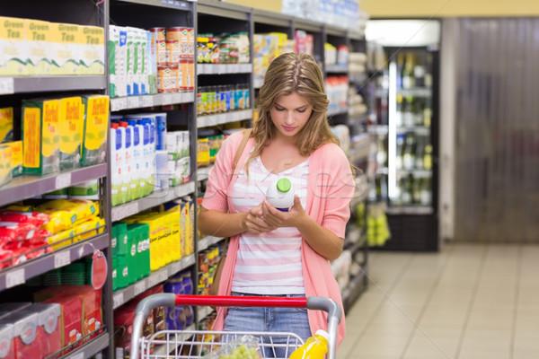 Güzel sarışın kadın satın alma ürünleri süpermarket pazar Stok fotoğraf © wavebreak_media