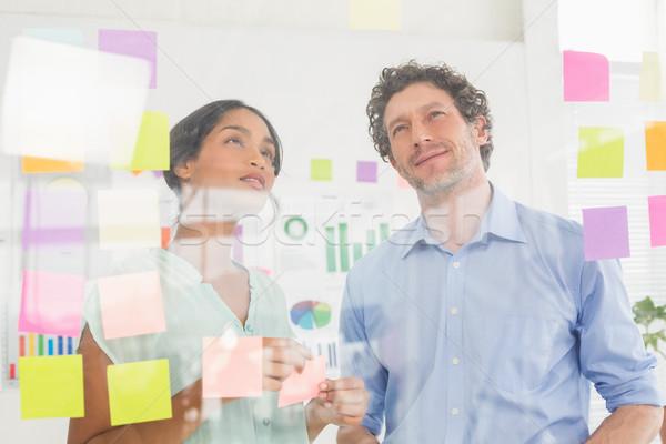 Onzeker business team naar post muur kantoor Stockfoto © wavebreak_media