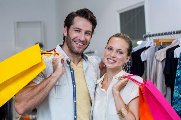 Sorridere Coppia abbigliamento store uomo Foto d'archivio © wavebreak_media