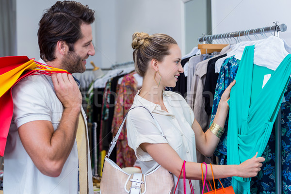 Smiling couple browsing clothes Stock photo © wavebreak_media