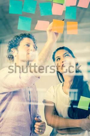 ビジネスの方々  接着剤 ノート ビジネスマン 女性実業家 ストックフォト © wavebreak_media