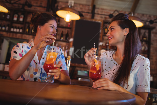 Two young women having cocktail drinks Stock photo © wavebreak_media