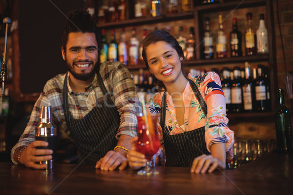 Portrait of happy waiter and waitress standing at counter Stock photo © wavebreak_media
